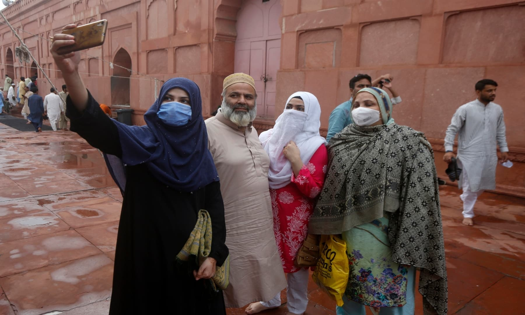 A family takes a selfie after Eidul Azha prayers at Badshahi mosque in Lahore. — AP