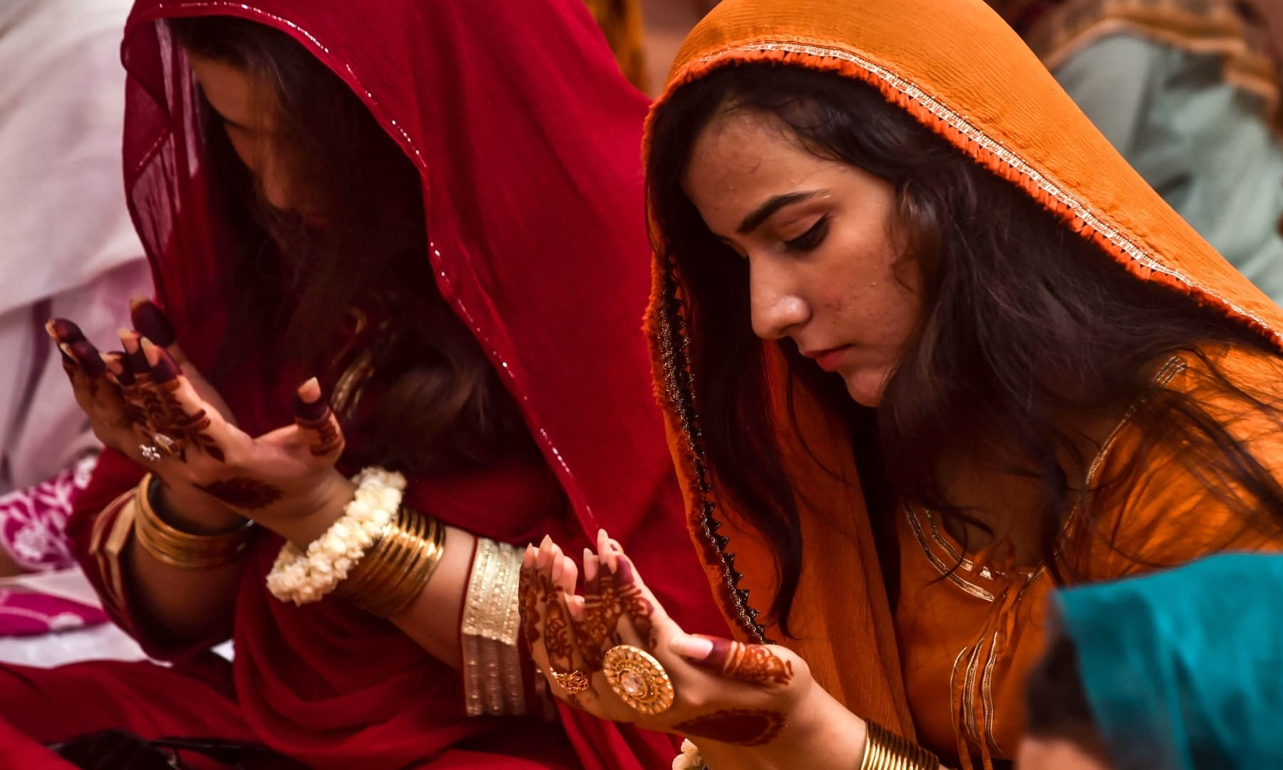 A woman offers prayers at the Badshahi mosque in Lahore on August 1, 2020. — AFP