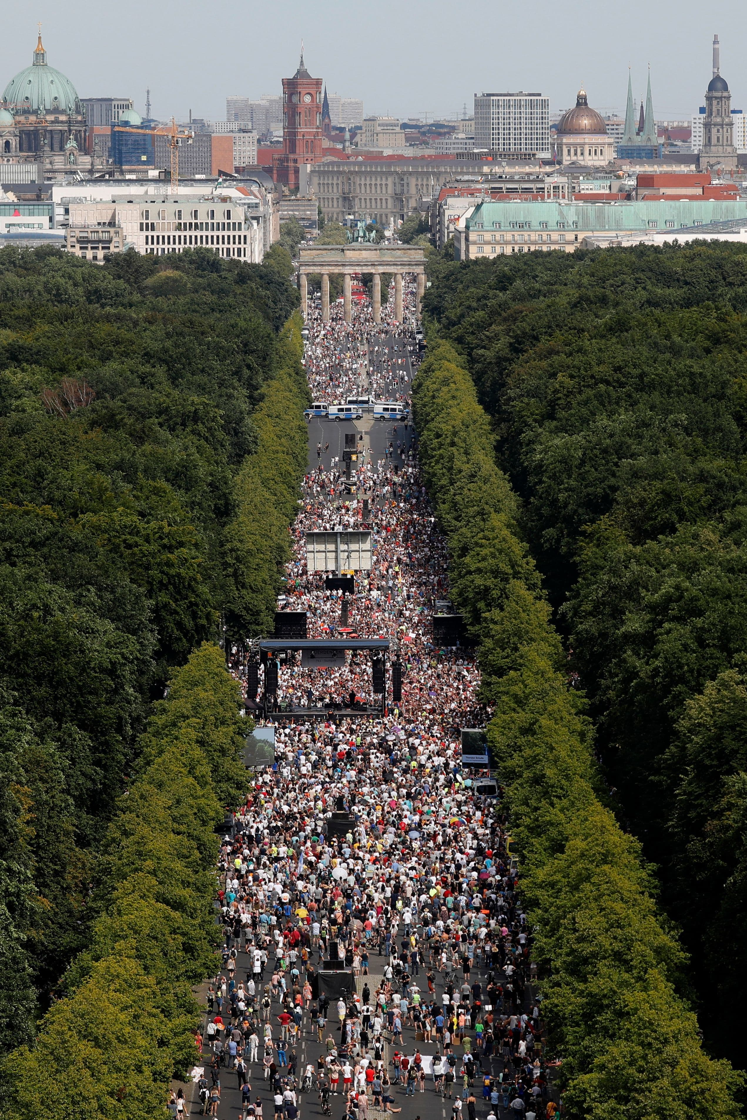 People gather at the Brandenburg gate for a demonstration in Berlin, Aug 1. — AP
