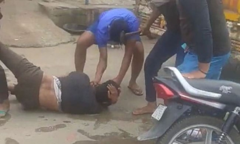 A group of men can be seen kicking and dragging the victim in the video. — Photo courtesy NDTV