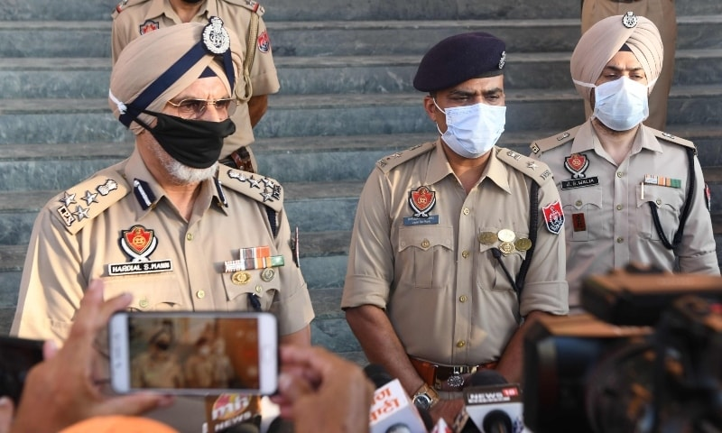 Punjab Police (DIG) Hardial Singh Mann (L) speaks to the media at Tarn Taran, some 25 km from Amritsar on August 1. — AFP
