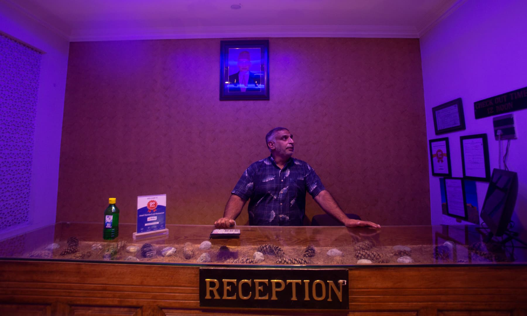 Kashmiri hotel manager Khurshid Ahmed stands at the reception counter of Hotel Standard during lockdown to stop the spread of the coronavirus in Srinagar, July 15, 2020. — AP