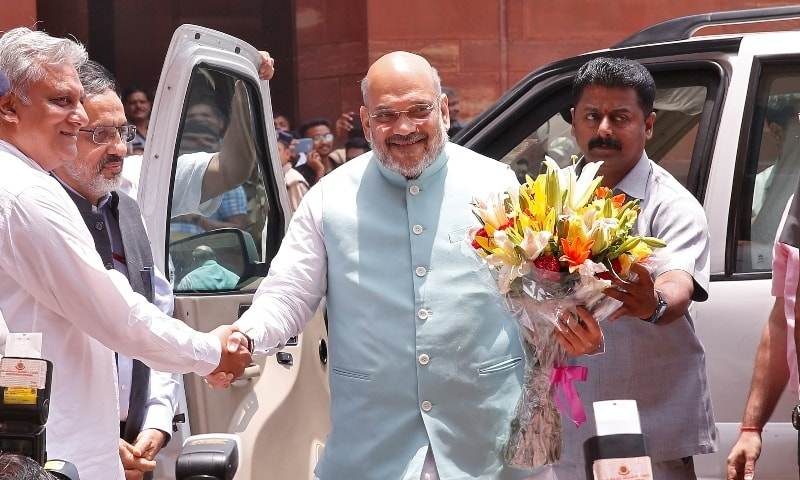 In this file photo, India's Interior Minister Amit Shah receives a flower bouquet upon his arrival at the home ministry in New Delhi on June 1, 2019. — Reuters