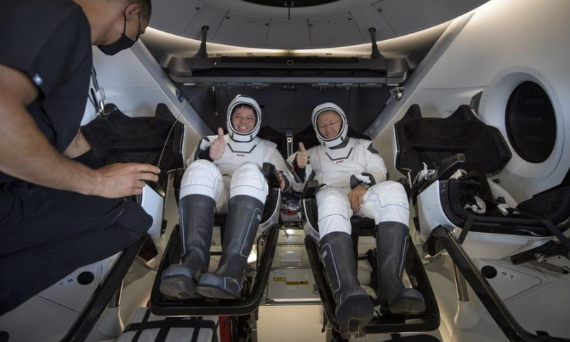Nasa astronauts Robert Behnken, left, and Douglas Hurley are seen inside the SpaceX Crew Dragon Endeavour spacecraft onboard the SpaceX GO Navigator recovery ship shortly after having landed in the Gulf of Mexico off the coast of Pensacola. — AP