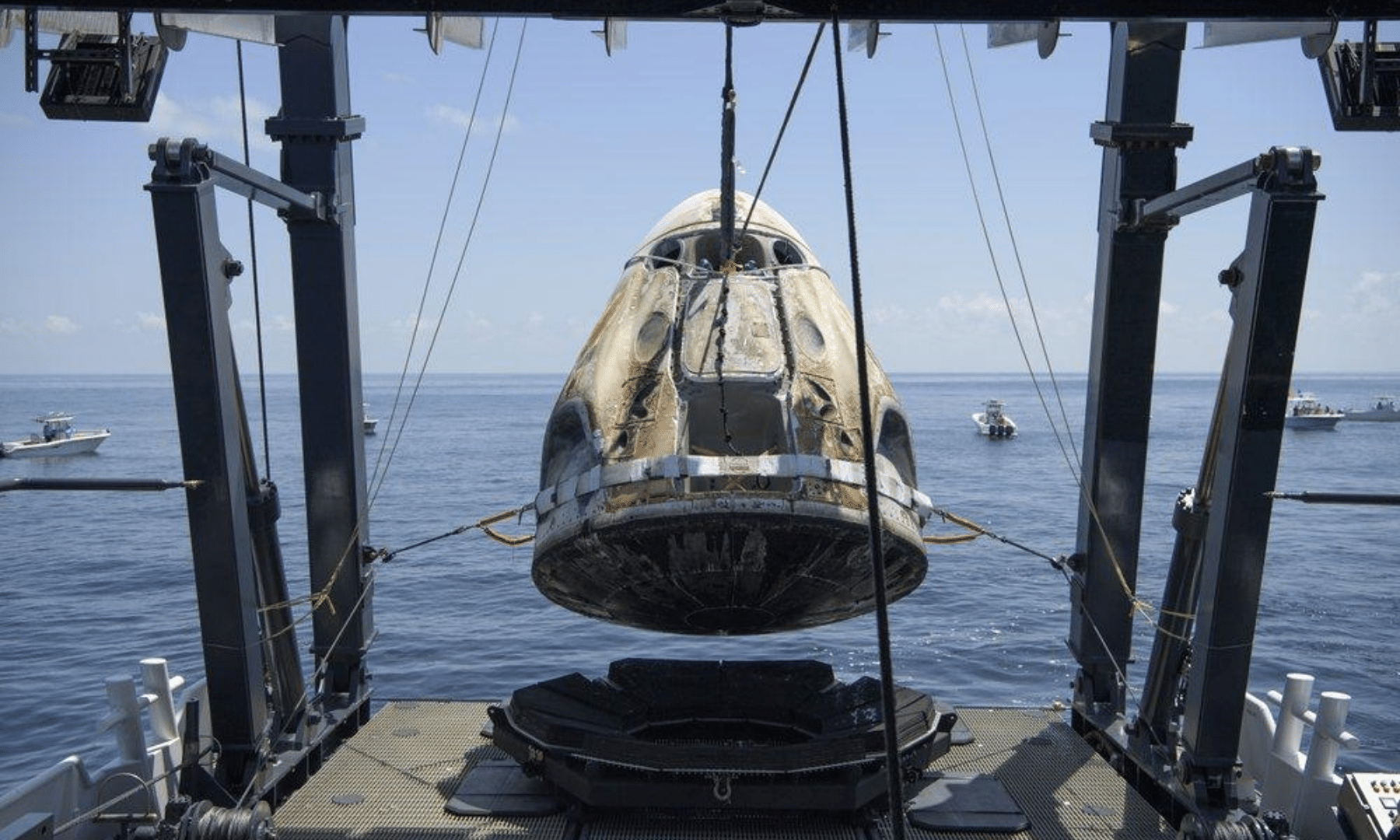 The SpaceX Crew Dragon Endeavour spacecraft is lifted onto the SpaceX GO Navigator recovery ship shortly after it landed. — AP