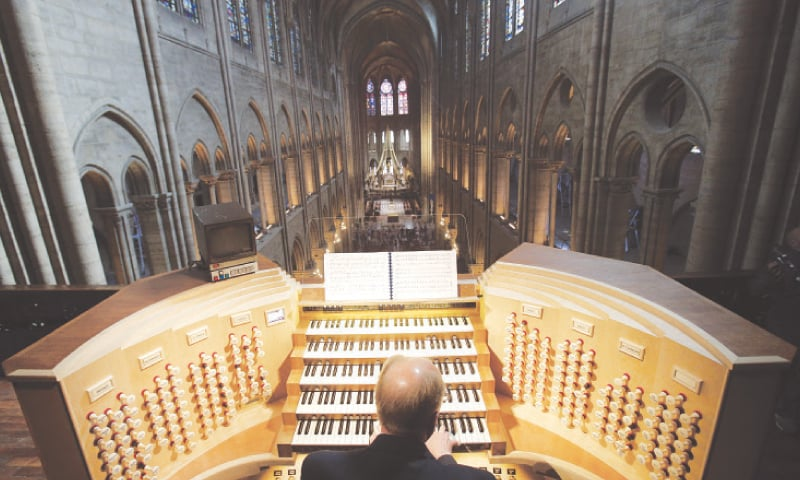 PARIS: This May 2, 2013, file photo shows Philippe Lefebvre, 64, playing the organ at Notre Dame cathedral.—AP
