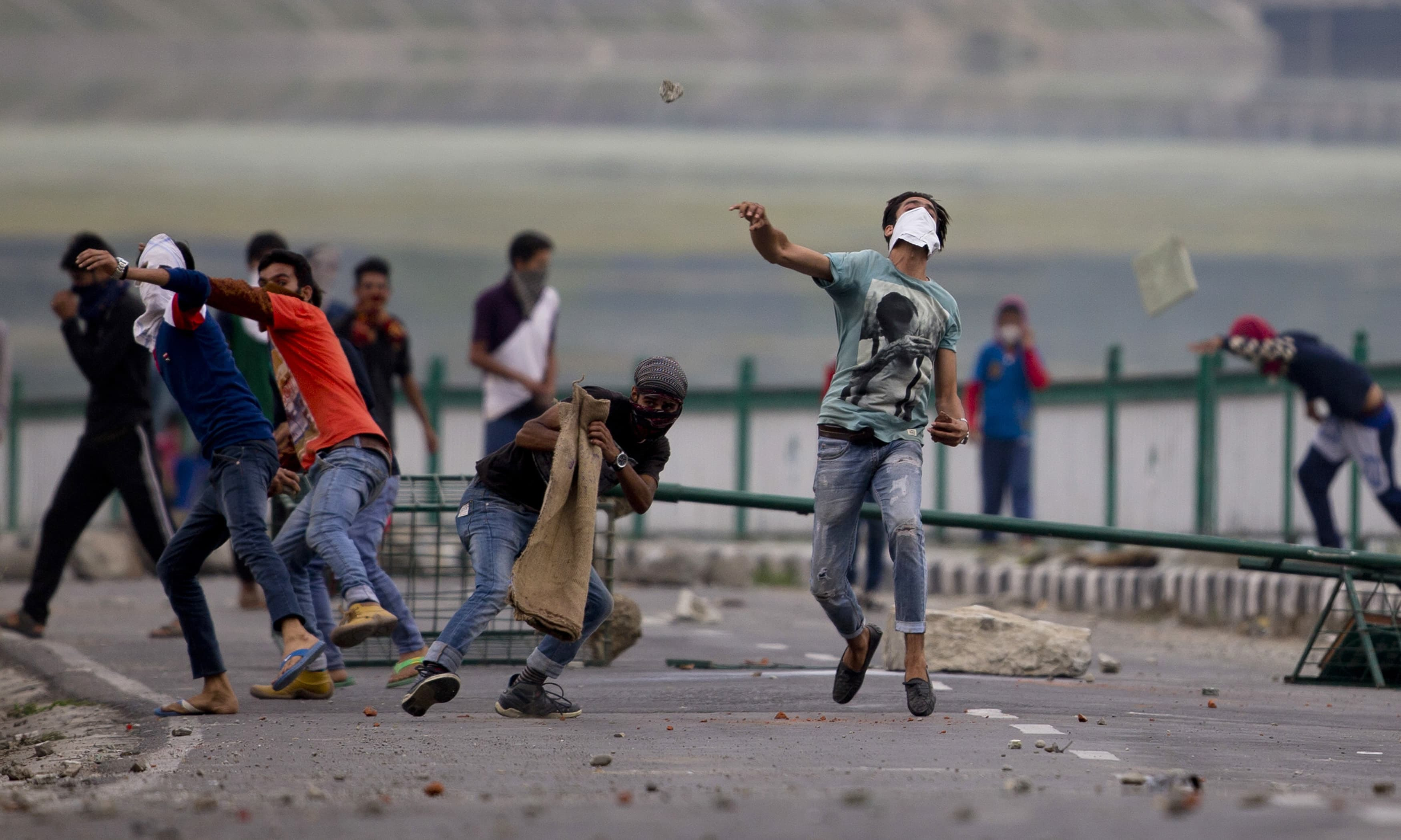 Kashmiri Muslim protesters throw stones at Indian troops in Srinagar, Indian controlled Kashmir, Tuesday, July 12, 2016. Clashes between Indian troops and protesters continued for fourth consecutive day despite a curfew imposed in the disputed Himalayan region to suppress anti-India violence following the Friday killing of Burhan Wani, chief of operations of Hizbul Mujahideen, Kashmir's largest rebel group. (AP Photo/Dar Yasin) — Copyright 2016 The Associated Press. All rights reserved. This material may not be pub