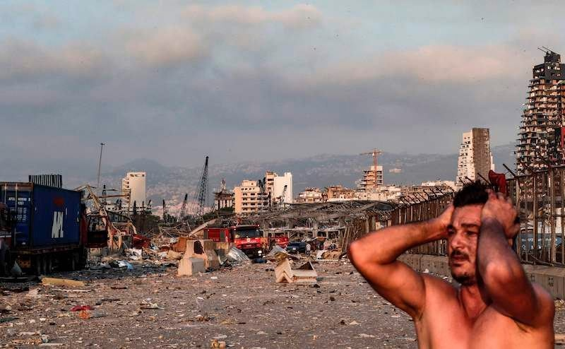 A man reacts at the scene of an explosion at the port in Lebanon's capital Beirut on August 4. — AFP