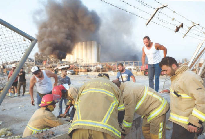 BEIRUT: Firefighters work at the scene of the explosion.—AFP