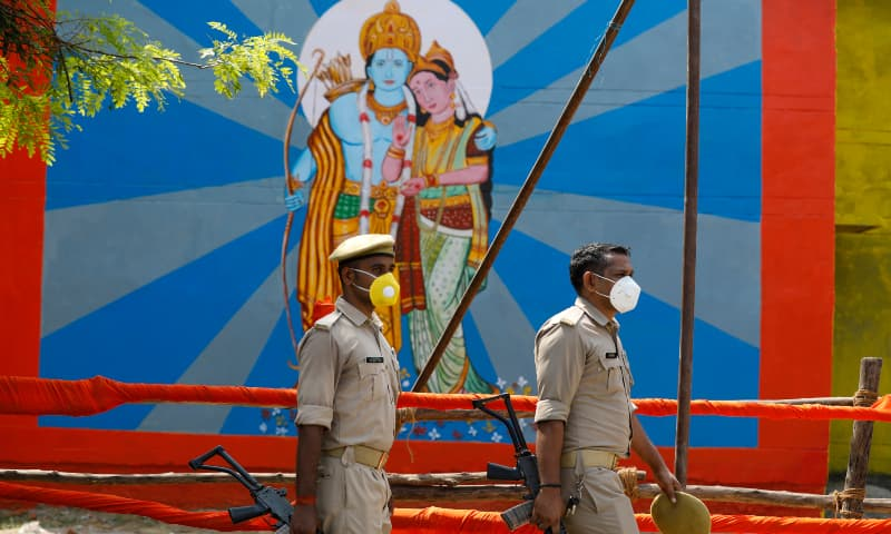 Policemen walk past an image of Hindu god Ram on the eve of a groundbreaking ceremony of a temple dedicated to Ram in Ayodhya, India, Tuesday, Aug 4. — AP