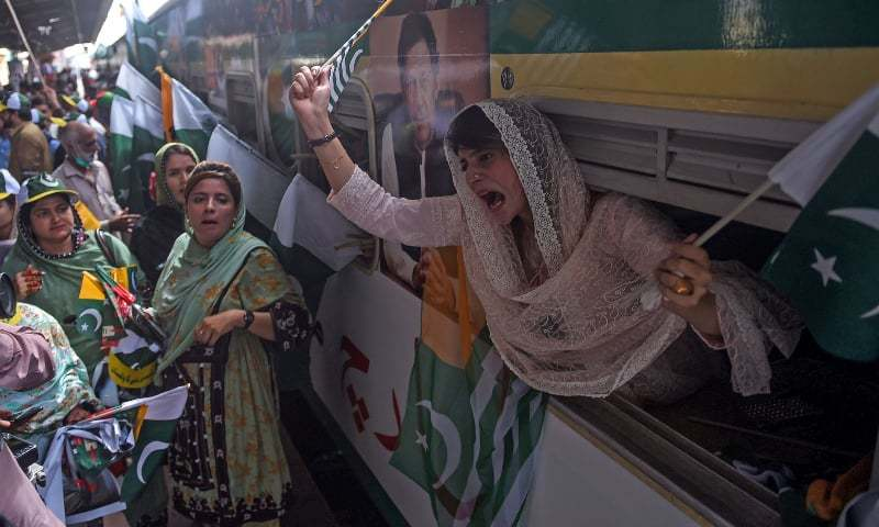 PTI supporters shout slogans during a train march to show solidarity with people of IOK in Karachi on August 5. — AFP