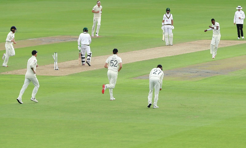 MANCHESTER: England paceman Jofra Archer (second R) celebrates the dismissal of Pakistan opener Abid Ali during the first Test at Old Trafford  on Wednesday.—AP