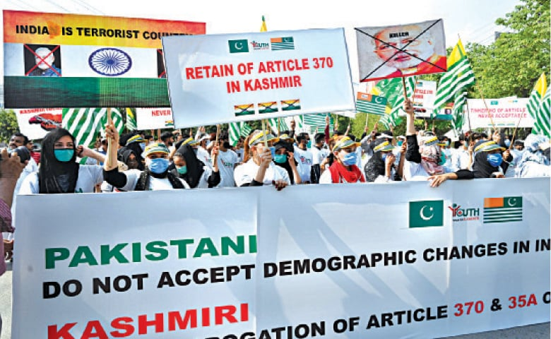 YOUTH Forum for Kashmir activists stage a rally at Shimla Pahari Chowk to express solidarity with the Kashmiris and mark one year of India's siege of held Kashmir. — White Star / M. Arif