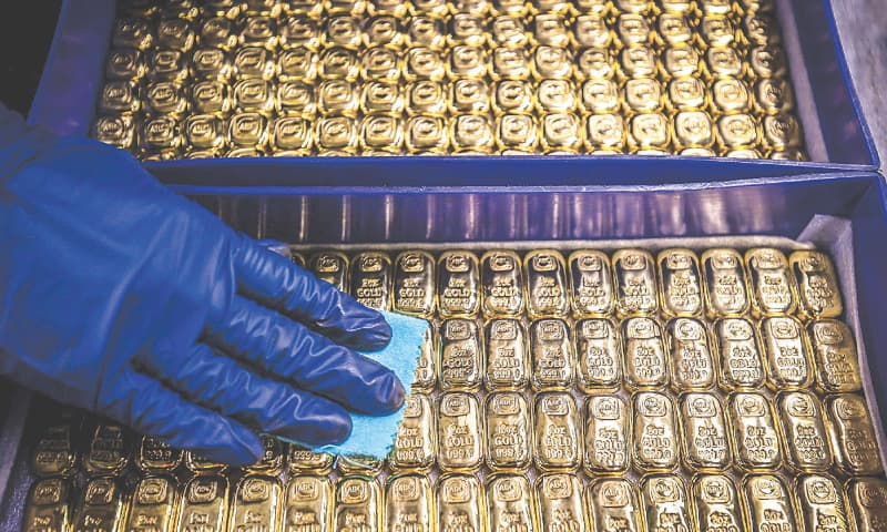 A worker polishes gold bullion bars at the ABC Refinery in Sydney on Wednesday.—AFP