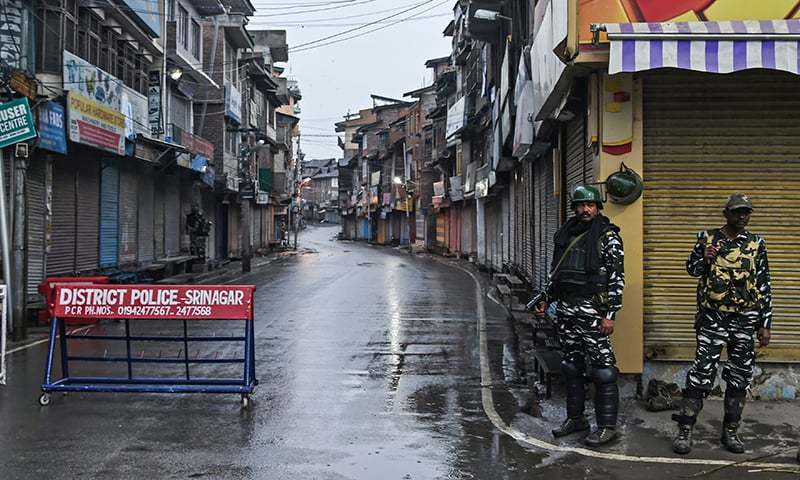 Security personnel stand guard during a lockdown in Srinagar on August 14, 2019. — AFP/File
