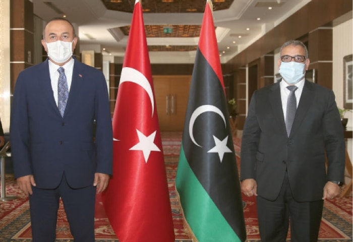 TRIPOLI:  Turkey's Foreign Minister Mevlut Cavusoglu (left) and Khalid Al Mishri, head of Libya's High Council of State, pose for a photo before their talks on Thursday.—AP