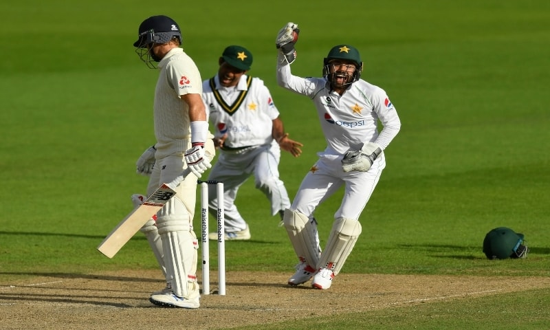 Pakistan's wicketkeeper Mohammad Rizwan, right, celebrates after taking the catch to dismiss England's captain Joe Root, left, during the second day of the first cricket Test match between England and Pakistan at Old Trafford in Manchester, England on Thursday, August 6, 2020. — AP