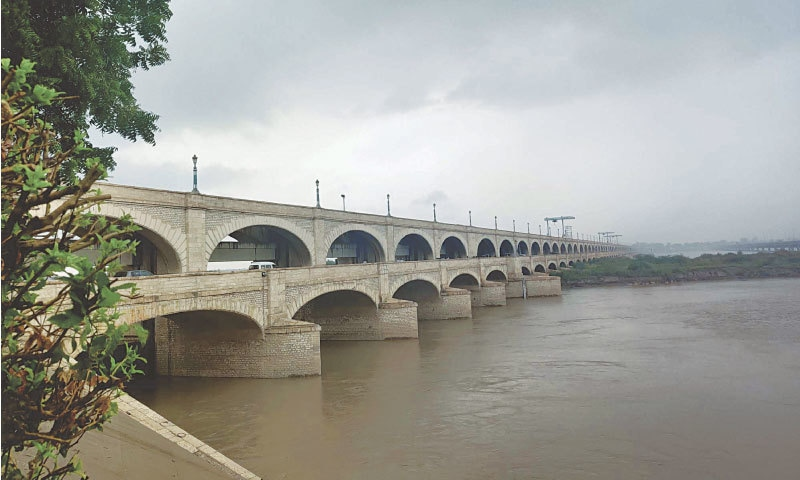 INDUS at Sukkur Barrage in high flood on Friday as widespread downpour continues in Sindh and other parts of the country for two days.—PPI