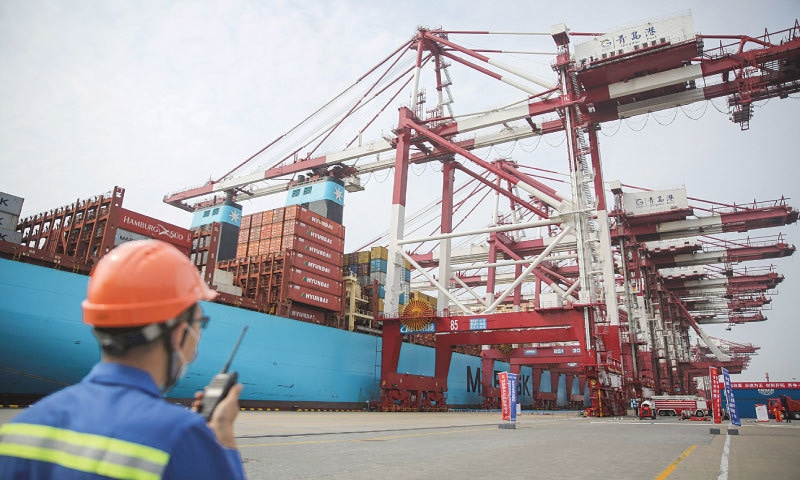 Qingdao (China): A staff member working at a port. China saw another surprise jump in exports in July as the global economy slowly reopened after virus lockdowns, data showed on Friday, but there were warnings that while the country is expected to get back on track by year's end, overseas shipments would likely struggle.—AFP file photo