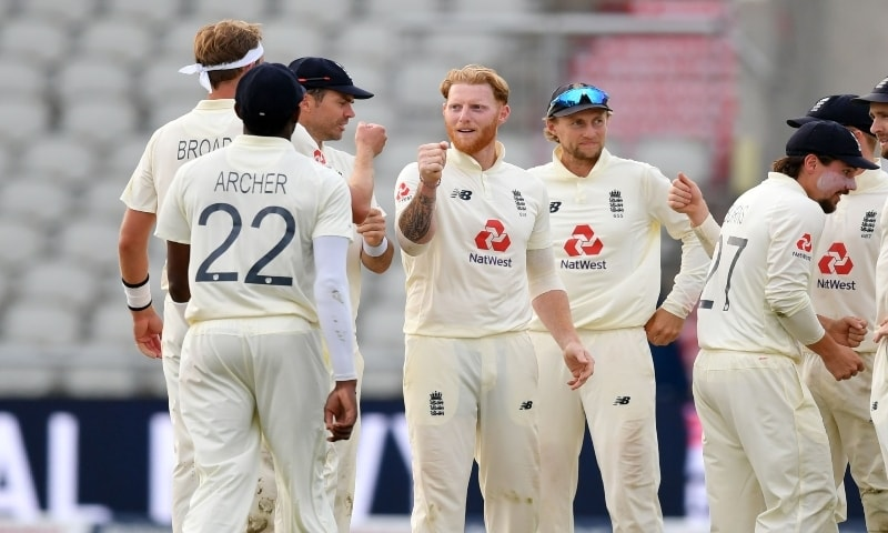 England's Ben Stokes (C) celebrates with teammates after taking the wicket of Pakistan's Shaheen Afridi on the third day of the first Test cricket match between England and Pakistan at Old Trafford in Manchester on August 7, 2020. — AFP
