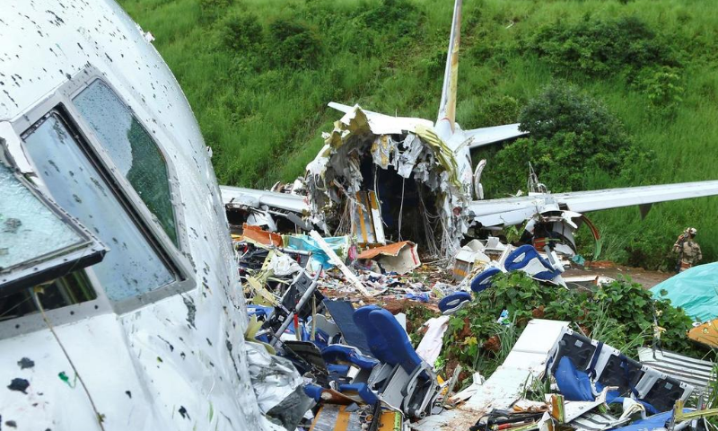 A security official inspects the site where a passenger plane crashed when it overshot the runway at the Calicut International Airport in Karipur, in the southern state of Kerala, India. — Reuters