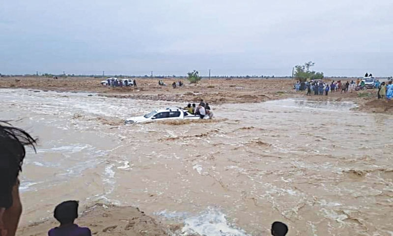 KHARAN: A vehicle stuck in floodwater in the Garok area on Saturday. — Dawn