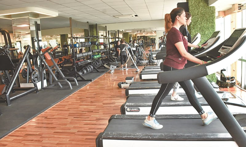ISLAMABAD: Staff pictured at a fitness centre on Saturday. Gyms, sports clubs, restaurants and cafes will be allowed to open from Monday in accordance with SOPs. — Online