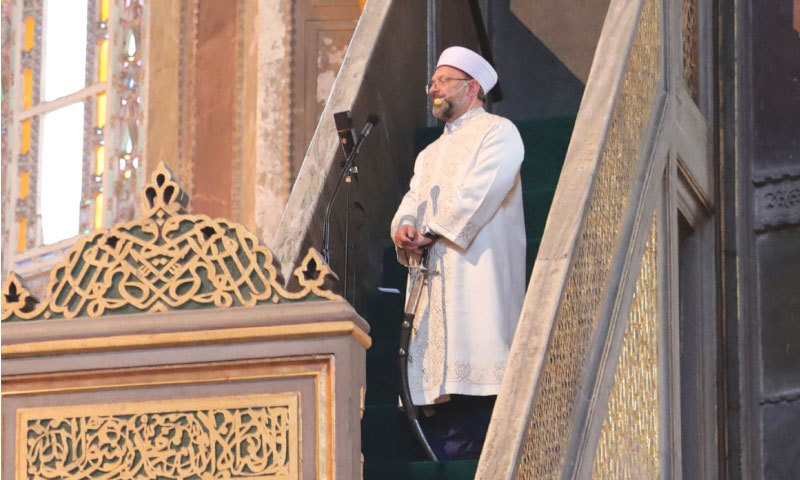 Ali Erba, the top imam and president of the controversial Directorate of Religious Affairs of Turkey, stands at the pulpit of Hagia Sophia, holding an Ottoman sword, before delivering the Friday sermon   Twitter