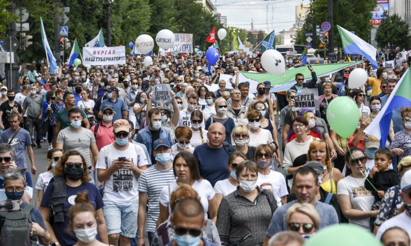 "People hold posters that read: ""I am, We are Sergei Furgal, Sergei Furgal our Governor"", during an unsanctioned protest in support of Sergei Furgal, the governor of the Khabarovsk region, in Khabarovsk on Aug 8. — AP"