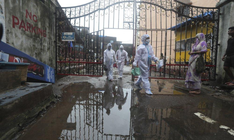 Health workers leave after screening people for Covid-19 symptoms at a residential building in Dharavi, one of Asia's biggest slums, in Mumbai, India on Aug 7. — AP