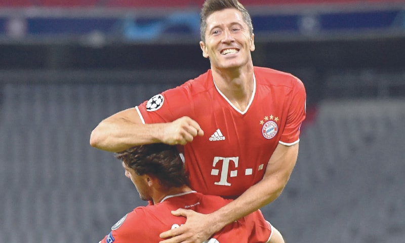 MUNICH: Bayern Munich's Robert Lewandowski (top) celebrates with team-mate Alvaro Odriozola after scoring during the Champions League round-of-16 second leg against Chelsea. — AFP