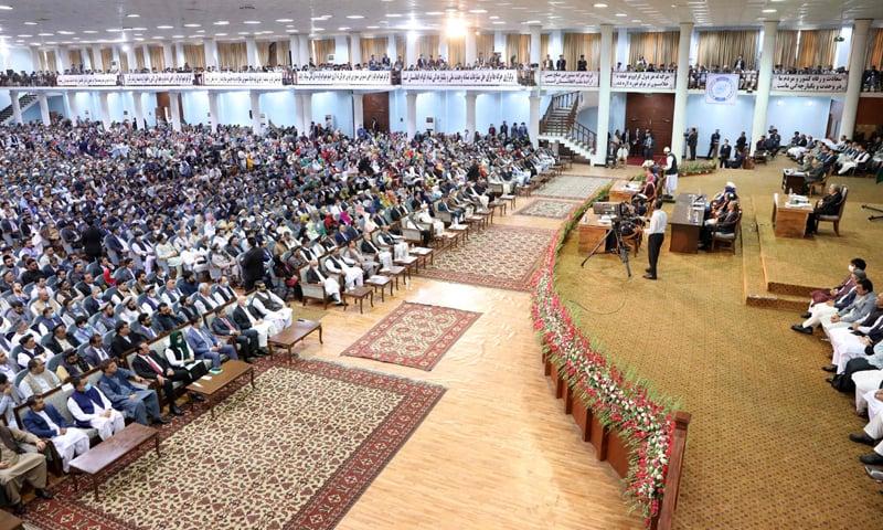 KABUL: Afghan people attend the Loya Jirga on Sunday.—AFP
