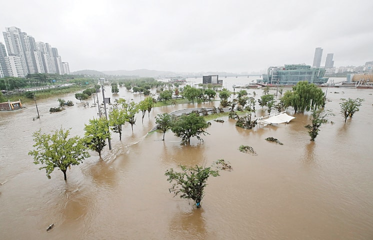 SEOUL: A part of a park near the Han River is flooded after heavy rain in the South Korean capital on Sunday.—AP