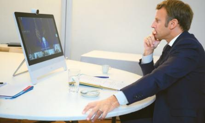 PARIS: French President Emmanuel Macron listens during a video conference on the situation in Lebanon on Sunday. — AP