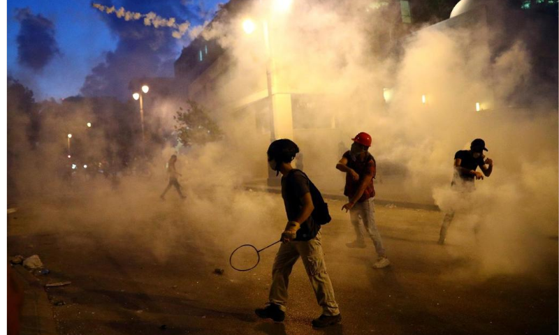 Demonstrators are seen during a protest following Tuesday's blast in Beirut, Lebanon on Aug 9. — Reuters