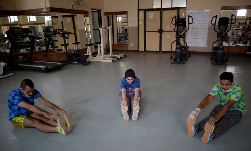 Athletes exercise at a gym following an ease in restrictions that had been imposed to help control the coronavirus, in Peshawar, Monday, Aug 10. — AP