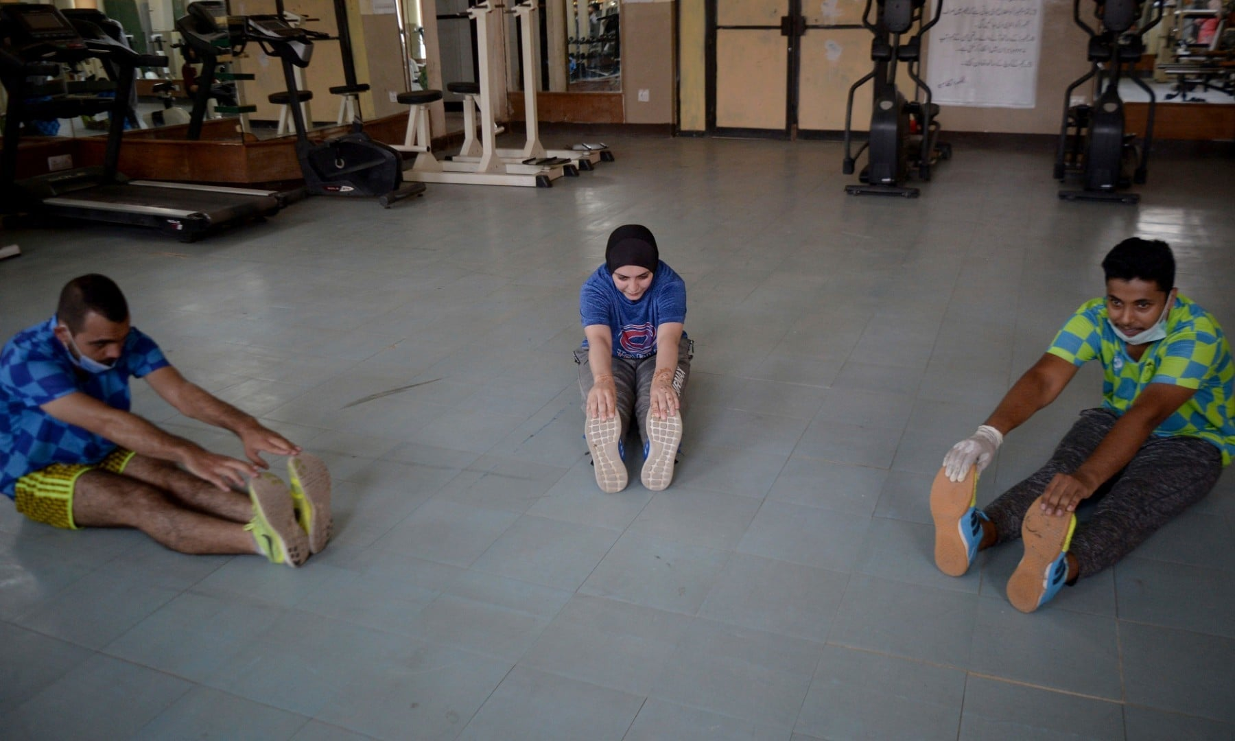 Athletes exercise at a gym following an ease in restrictions that had been imposed to help control the coronavirus in Peshawar on August 10. — AP