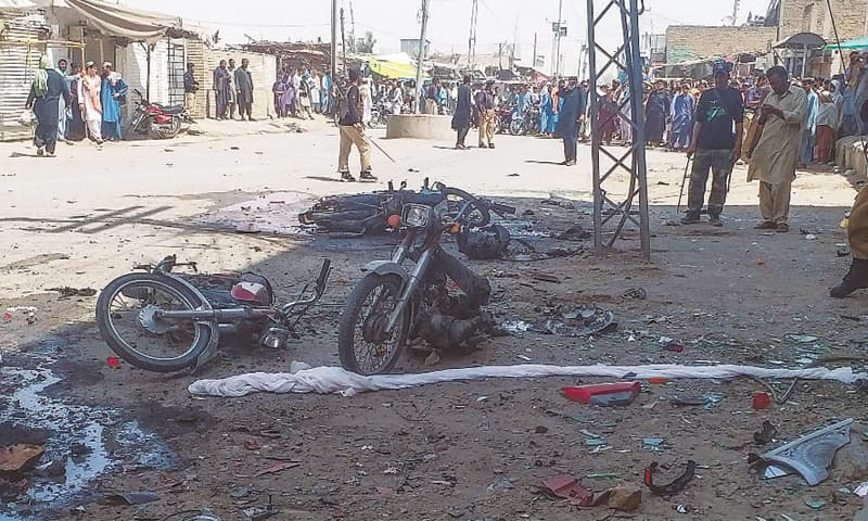 Chaman: Policemen stand guard at the site of the bomb explosion on Monday.—AFP