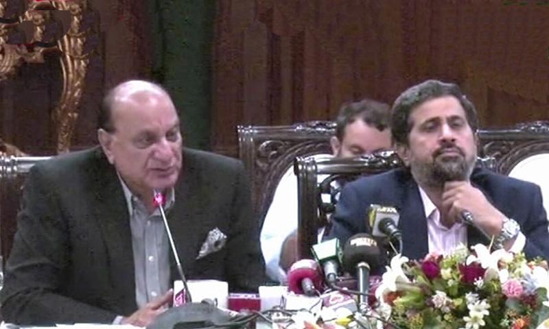 Punjab Law Minister Raja Basharat and Information Minister Fayazul Hassan Chohan address a press conference. — DawnNewsTV
