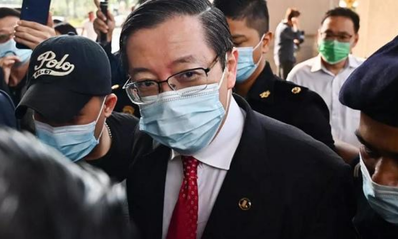 Lim was charged with abusing his position to get 372,009 ringgit ($88,573) in gratification for his wife Betty Chew over a workers' dormitory project. — AFP/File