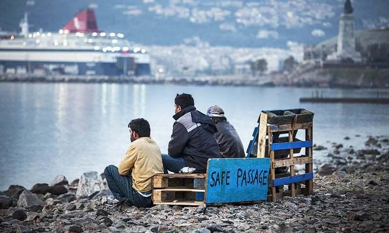 Pakistani men at the No Borders camp at the port of Mytilene, Lesbos island, on April 7, 2016. — Jodi Hilton/ File