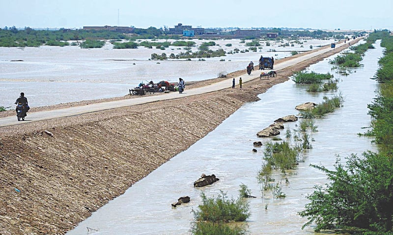 A PATHWAY connecting scores of villages in the Kachho area resurfaces after floodwater receded on Wednesday. — Dawn