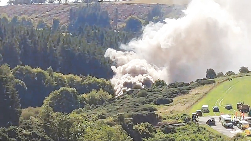 EDINBURGH: A still image taken from video footage shows smoke billowing from the scene of a train crash near Stonehaven, in north-eastern Scotland, on Wednesday. — AFP