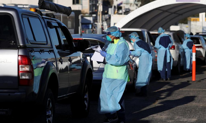 Medical personnel administer tests for the coronavirus at the Bondi Beach drive-through testing centre, as the state of New South Wales grapples with an outbreak of new cases, in Sydney, Australia. — Reuters/File