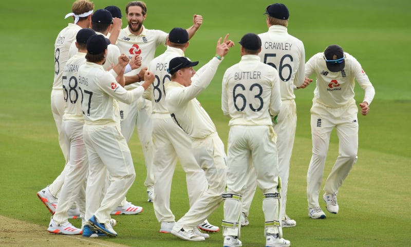 England players celebrate the wicket of Pakistan's Fawad Alam after a review on the first day of the second Test between England and Pakistan at the Ageas Bowl in Southampton, southwest England on August 13. — AFP