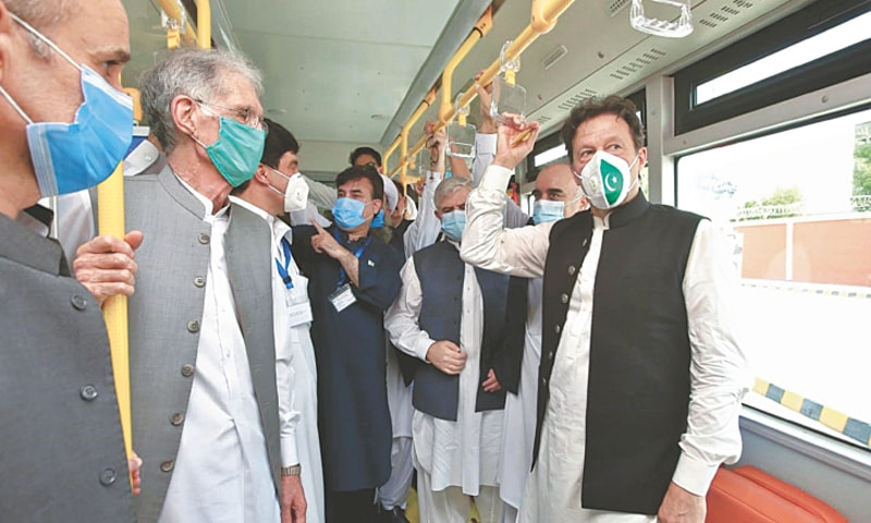 PESHAWAR: Prime Minister Imran Khan travelling on a bus after the inauguration of the BRT service on Thursday.—White Star