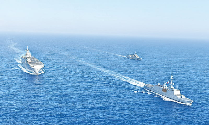 ATHENS: An undated handout image released on Wednesday by Greece shows  Greek and French vessels sailing in formation during a joint military exercise in Mediterranean Sea.—Reuters