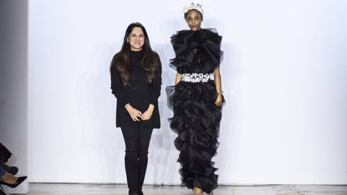 Sania Maskatiya poses with a model at NYFW