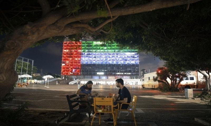 Tel Aviv City Hall is lit up with the flags of the United Arab Emirates and Israel as the countries announced they would be establishing full diplomatic ties on Thursday. — AP
