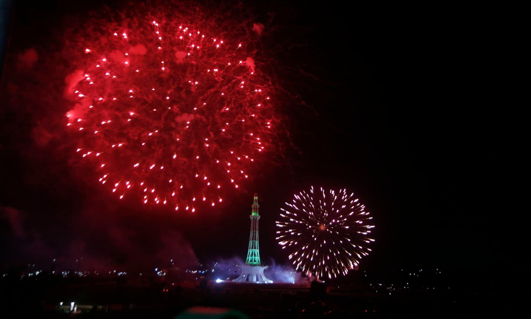 Fireworks light the sky close to the Minar-e-Pakistan during Independence Day celebrations, in Lahore on Friday. — AP